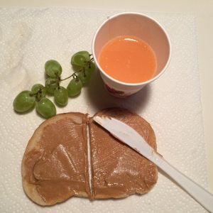 Peanut butter on Ed's sourdough bread with grapefruit juice and organic green grapes
